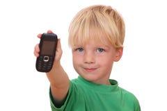 Menino com telefone de pilha Imagens de Stock