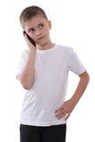 Menino com telefone móvel Imagem de Stock Royalty Free