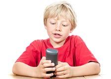 Menino com telefone sem fio Imagens de Stock Royalty Free
