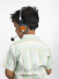 Menino com telefones principais Imagem de Stock Royalty Free
