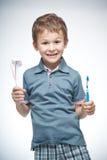 Menino com toothbrush imagens de stock royalty free