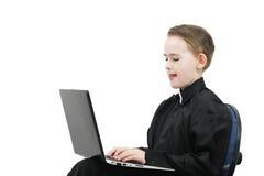 Menino com um computador Fotos de Stock Royalty Free