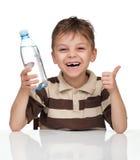 Menino com um frasco da água Foto de Stock Royalty Free
