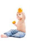 Menino com uma laranja Foto de Stock Royalty Free