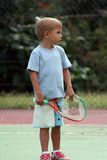 Menino com uma raquete Foto de Stock