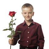 Menino com uma rosa vermelha Foto de Stock Royalty Free