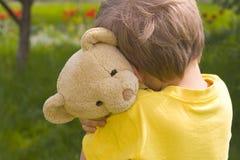 Menino com urso Foto de Stock Royalty Free