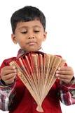 Menino com ventilador japonês Imagens de Stock Royalty Free