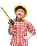 Menino como um trabalhador da construção com fita métrica Fotos de Stock