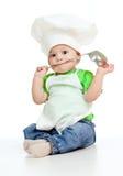 Menino da cozinha com concha imagem de stock royalty free