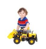 Menino da criança de três anos com seu brinquedo Imagens de Stock Royalty Free