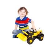 Menino da criança de três anos com seu brinquedo Fotografia de Stock Royalty Free