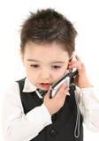 Menino da criança no terno no telemóvel Imagem de Stock Royalty Free
