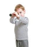 Menino da criança que anticipa com o telescópio isolado Imagens de Stock Royalty Free