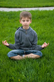 Menino da ioga fotografia de stock