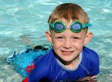 Menino da natação foto de stock