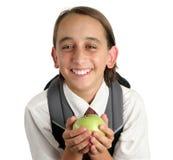 Menino de escola adorável com Apple imagem de stock