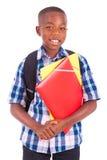 Menino de escola afro-americano, guardarando dobradores - pessoas negras Fotos de Stock