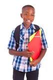 Menino de escola afro-americano, guardarando dobradores - pessoas negras Fotografia de Stock