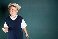 Menino de escola com giz Imagens de Stock Royalty Free