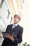 Menino de escola com tabuleta eletrônica fotografia de stock royalty free