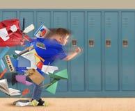 Menino de escola que corre tarde com fontes no corredor Imagem de Stock Royalty Free