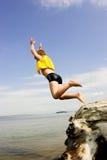 Menino de Jumpimng Imagens de Stock Royalty Free