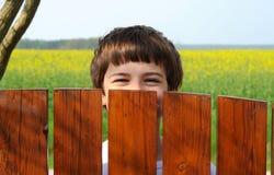 Menino de riso Fotos de Stock