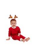 Menino de riso com a faixa do cabelo da rena Imagens de Stock