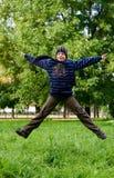 Menino de salto Foto de Stock Royalty Free