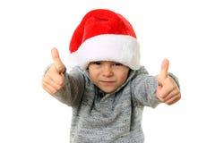 Menino de Santa com polegares acima Fotos de Stock Royalty Free