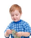 Menino de sorriso com a nota de banco do dólar do dinheiro. Imagens de Stock Royalty Free