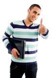 Menino de sorriso com portátil e polegares acima Imagem de Stock Royalty Free