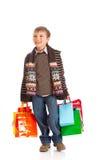 Menino de sorriso com sacos de compra foto de stock royalty free
