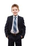 Menino de sorriso da criança no terno de negócio Imagem de Stock