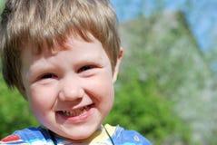 Menino de sorriso feliz Fotografia de Stock Royalty Free