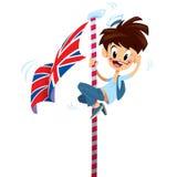 Menino de sorriso feliz entusiasmado dos desenhos animados que escala no polo de bandeira inglês Fotografia de Stock Royalty Free