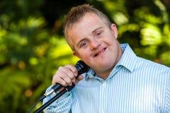 Menino deficiente que guarda o microfone Fotografia de Stock