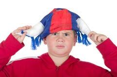 Menino descontentado em um capacete do ventilador imagens de stock