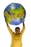 Menino do americano africano que prende um globo Foto de Stock