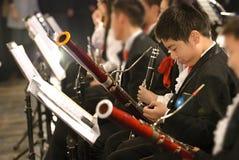 Menino do Bassoon no concerto Foto de Stock