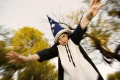 Menino do feiticeiro com as mãos outstreached imagem de stock royalty free