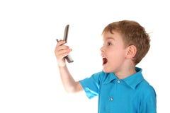Menino do grito com telefone fotografia de stock
