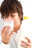 Menino do leite Fotografia de Stock