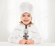 Menino do microscópio fotografia de stock royalty free