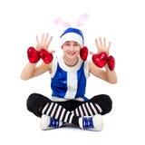 Menino do Natal no chapéu azul de Santa com corações Fotos de Stock Royalty Free