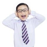Menino do negócio que grita no fundo branco Foto de Stock