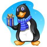 Menino do pinguim com presente Fotografia de Stock Royalty Free