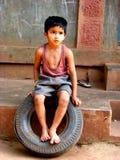 Menino do pneumático Imagem de Stock