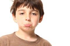 Menino dos anos de idade sete que olha triste Fotos de Stock Royalty Free